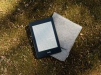 Kindle e-book reader on gray flip cover case